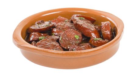 vino: Chorizo al Vino Spicy sausage cooked in red wine. Traditional Spanish tapas dish.