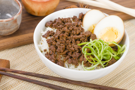 Lu Rou Fan Taiwanese Braised Pork Rice Bowl - Ground pork marinated and boiled in soy sauce served on top of steamed rice. Stock Photo