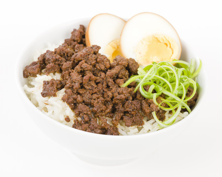 rou: Lu Rou Fan Taiwanese Braised Pork Rice Bowl - Ground pork marinated and boiled in soy sauce served on top of steamed rice. Stock Photo
