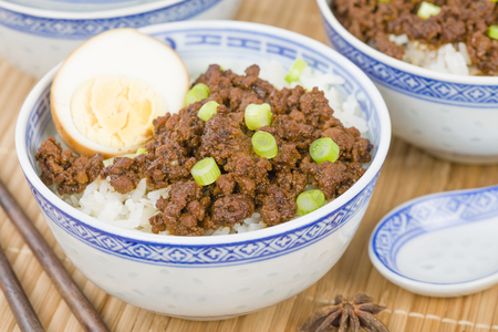 taiwanese: Lu Rou Fan Taiwanese Braised Pork Rice Bowl - Ground pork marinated and boiled in soy sauce served on top of steamed rice. Stock Photo