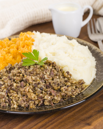 robert: Haggis, Neeps  Tatties - Traditional Scottish meal commonly served at Burns Night. Served with whisky sauce.