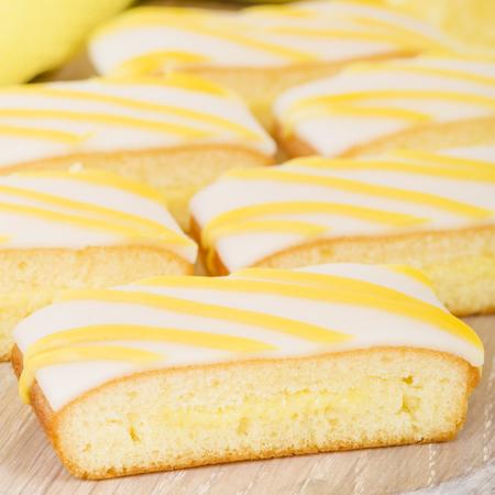 lemony: Lemon Drizzle Cake - Slices of lemon cake topped with icing.