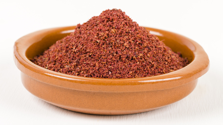 Sumac - Middle Eastern spice used to to add a lemony taste to salads or meat. Reklamní fotografie - 49876720