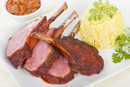 cutlets: Lamb Cutlets - Spicy roasted lamb cutlets served saffron rice and dips. Stock Photo