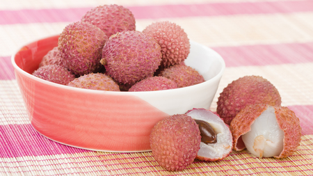 lychees: Lychees - Fresh lychees in a pink bowl.