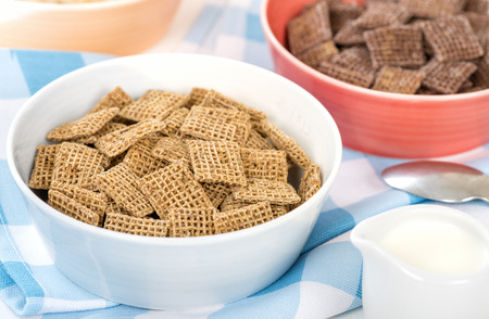 bue: Shreddies - Whole grain wheat cereals in a bue bowl.