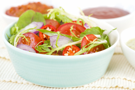 rocket lettuce: Mixed Leaf  Vegetable Summer Salad - Salad with tomatoes, rocket, lettuce, red onions and peppers. Stock Photo