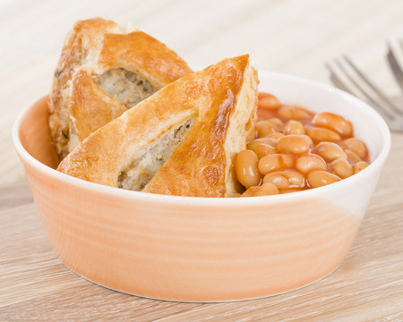 Sausage Roll  Beans - Bowl of sausage roll and baked beans.