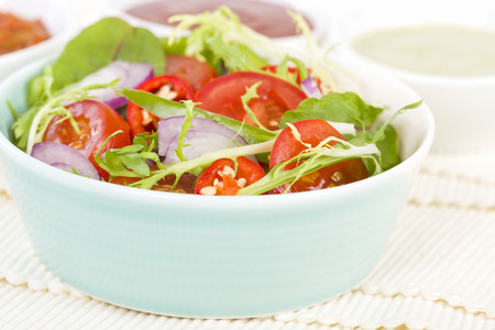 Mixed Leaf  Vegetable Summer Salad - Salad with tomatoes, rocket, lettuce, red onions and peppers. Stock Photo