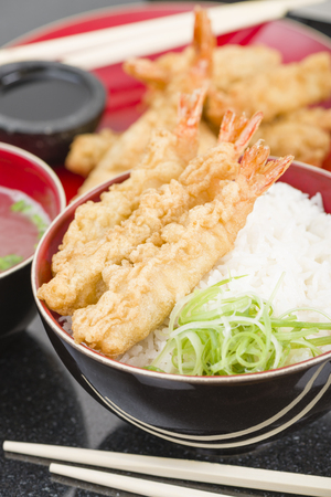 Ebi Tendon - Prawn tempura on top of boiled rice served with miso soup. Stock Photo