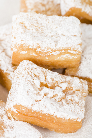 Yum Yum - Sweet toffee flavoured fried pastry dusted with icing sugar.