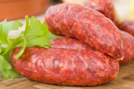 Chorizo - Spicy sausage on a wooden board. Reklamní fotografie