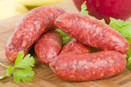 Chorizo - Spicy sausage on a wooden board. Stock Photo