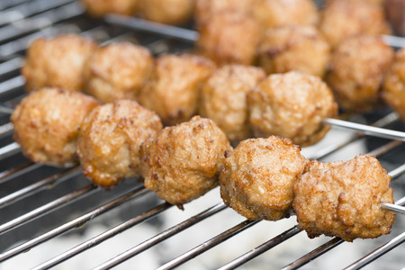 BBQ Meatballs - Meatballs on metal skewers being grilled on a barbecue. Reklamní fotografie