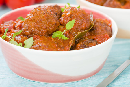Albondigas Guisadas - Meatballs in tomato sauce with thyme leaves.
