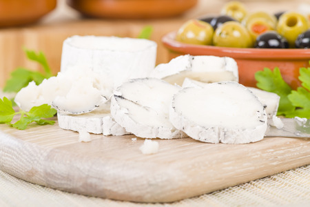 Goats Cheese  Olives - Full fat mould ripened soft goats milk cheese served with mixed olives. Reklamní fotografie