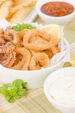 Calamari - Deep-fried squid rings served with garlic mayo and chili sauce. Stock Photo
