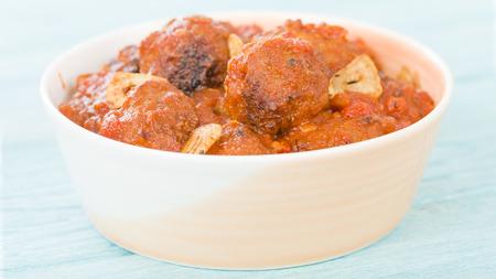 slivers: Albondigas Guisadas - Meatballs in tomato sauce with garlic slivers.