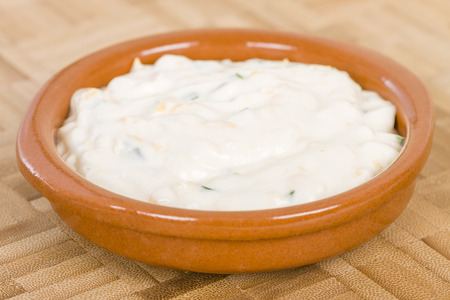 Cheese  Chive Sauce - Dipping sauce with cream, cheese and chives in a terracotta bowl. Stock Photo