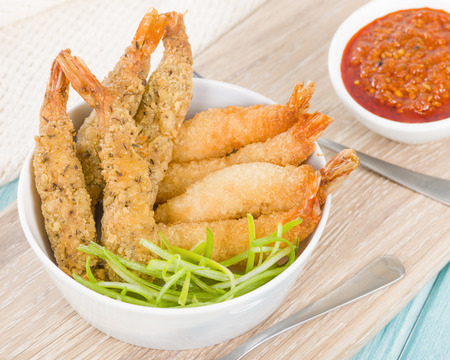 finger food: Breaded Prawns - King prawns coated in plain and spicy breadcrumbs and deep-fried.