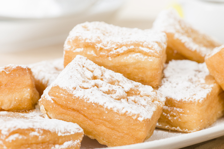 yum: Yum Yum - Sweet toffee flavoured fried pastry dusted with icing sugar.