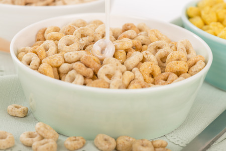 Cheerios - Bowl with cheerios whole grain cereals. Stock Photo