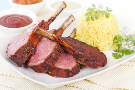 Lamb Cutlets - Spicy roasted lamb cutlets served saffron rice, salad and dips.