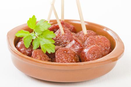 chorizo: Chorizo a la Sidra - Spanish spicy chorizo sausages cooked in cider. Stock Photo