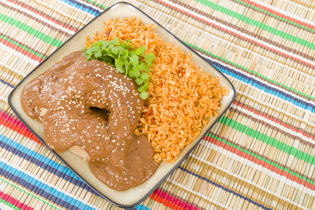 Mole Poblano - Chicken with mole sauce and tomato rice. Traditional Mexican food.