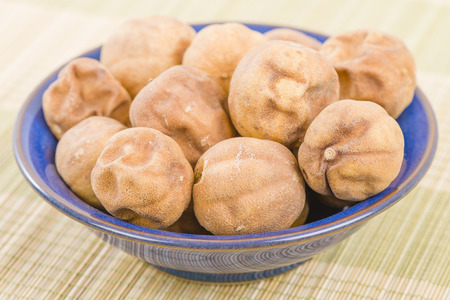 basra: Dried Limes - Middle Eastern dried limes in a blue bowl. Stock Photo