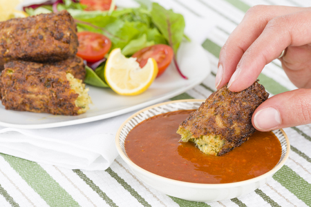 squeak: Vegetarian Sausage - Bubble and squeak sausages with salad and chili sauce. Stock Photo