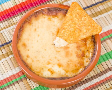 cazuela: Baked Cheese - Melted cheese dip served with tortilla chips.