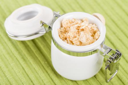 tight filled: Garlic Salt - Sea salt infused with garlic in a jar. Stock Photo