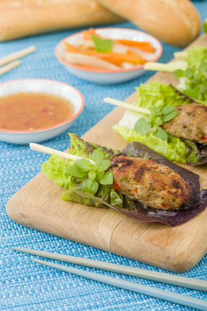 nem: Nem Nuong Xa - Vietnamese minced pork sausages on lemongrass skewers served do chua, nouc cham and chili sauce.