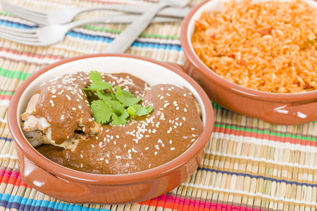 cazuela: Mole Poblano - Chicken with mole sauce and side dishes. Traditional Mexican food.