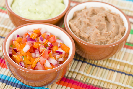 side dishes: Mexican Dips  Side Dishes - Salsa, Guacamole and Refried Beans. Stock Photo