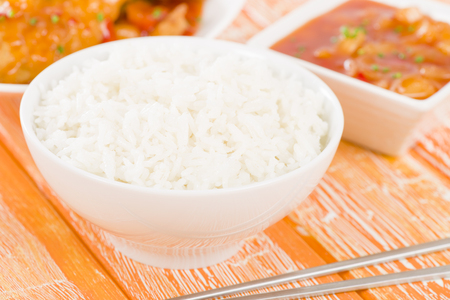 sweet and sour: Steamed Rice - Boiled rice in a bowl. Sweet  sour sauce on background. Stock Photo