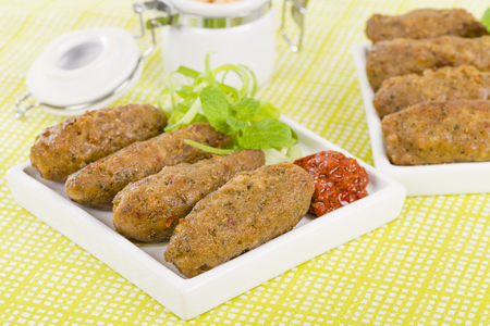 bbq chicken: Koftas - Lamb koftas served with harissa.