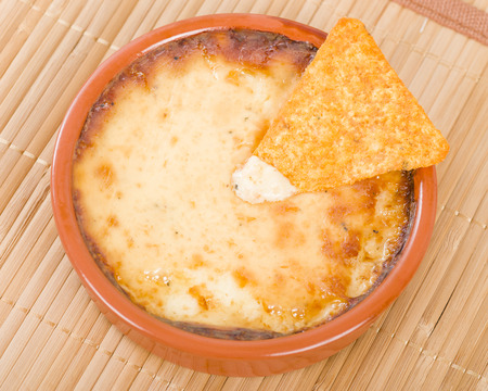 melted cheese: Baked Cheese - Melted cheese dip served with tortilla chips.