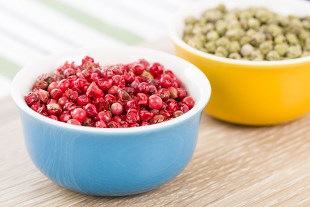 peppertree: Pink  Green Peppercorns - Bowls with dried pink and green peppercorns.