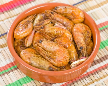 sizzling: Gambas Pil Pil Sizzling prawns. Traditional Spanish tapas dish.