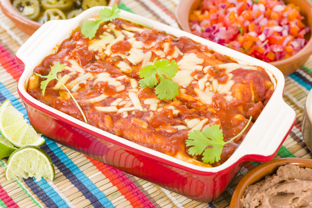 Chicken  Chorizo Enchiladas - Mexican soft tortilla filled with chorizo and chicken cooked in spicy tomato sauce served with salsa.