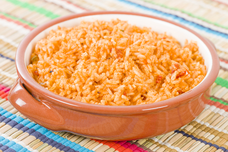 chicken rice: Mexican Rice - Rice cooked with tomato sauce and chicken broth.