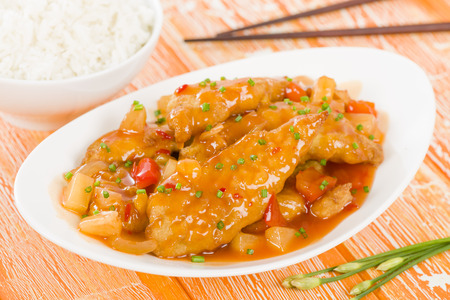 Sweet  Sour Chicken - Chinese style battered chicken breast fillets with sweet and sour sauce served steamed rice.