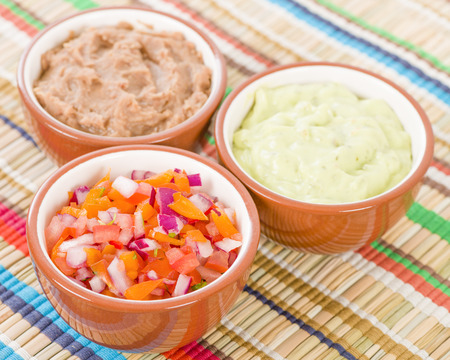 side dishes: Mexican Dips  Side Dishes - Salsa, Refried Beans and Guacamole. Stock Photo