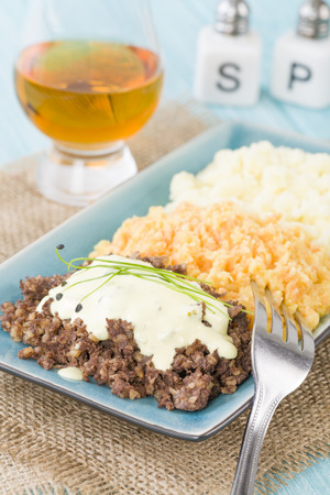 burns night: Haggis, Neeps  Tatties - Traditional Scottish meal commonly served at Burns Night. Served with whisky sauce.