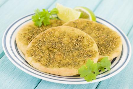 Zaatar Manakish - Flatbread topped with zaatar and olive oil. Traditional Arab food.