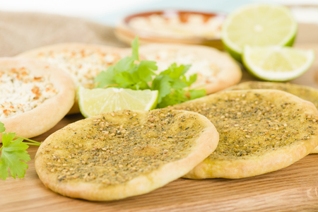 Zaatar  Cheese Manakish - Flatbreads topped with zaatar and olive oil and cheese. Traditional Arab food.