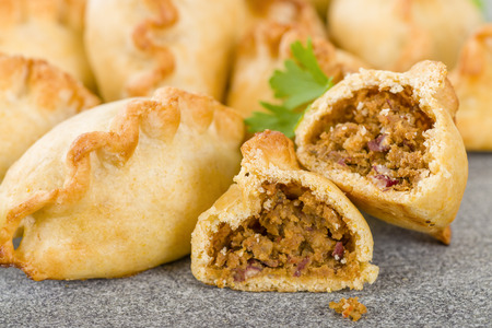 Cornish Pasty - Baked pasty filled with meat and potatoes. Cornwalls traditional dish.
