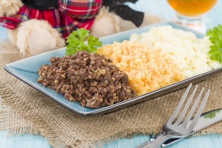 burns night: Haggis, Neeps  Tatties - Traditional Scottish meal commonly served at Burns Night. Served with a dram and whisky sauce. Stock Photo